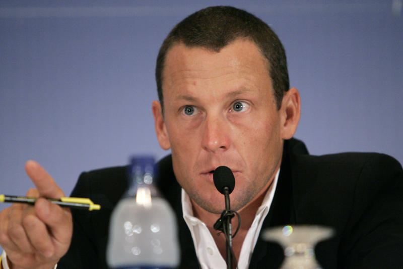 FILE - In this July 28, 2006 file photo, Lance Armstrong testifies during a U.S. Senate field hearing on cancer research and funding in Iowa City, Iowa. Armstrong is facing a Wednesday, Feb. 20, 2013 deadline to decide whether he will meet with U.S. Anti-Doping Agency officials and talk with them under oath about what he knows about performance-enhancing drug use in cycling. The agency has said Armstrong's cooperation in its cleanup effort is the only path open to Armstrong if his lifetime ban from sports it to be reduced.(AP Photo/Charlie Neibergall, File)