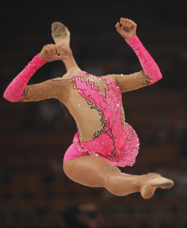 Dara Dmitrieva of Russia performs with a skipping-rope, unseen, as thrown into air, during the final of the rhythmic gymnastics World Cup 2009 tournament, in Ukraine's capital Kiev, on Sunday, Aug.16, 2009. (AP Photo/Efrem Lukatsky)