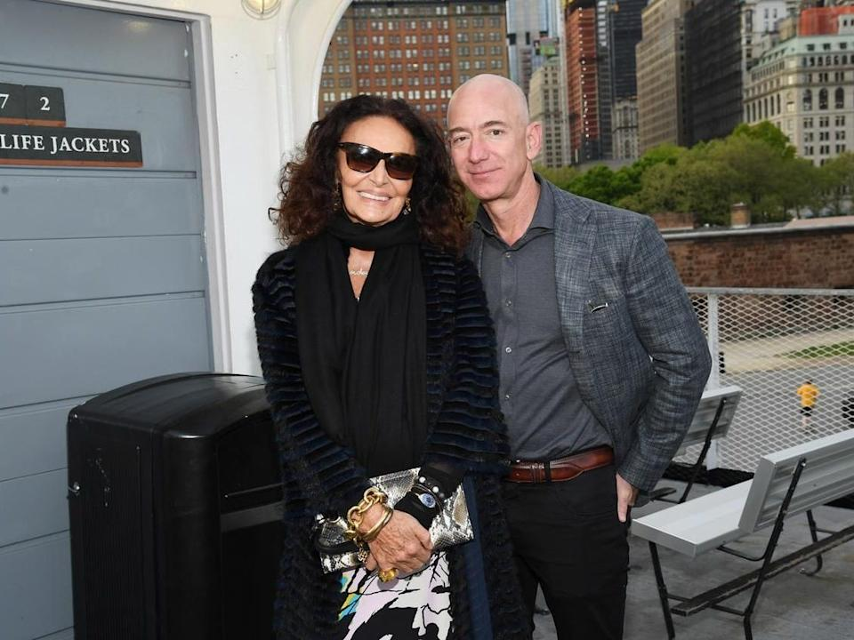 """Diane von Furstenberg and Jeff Bezos pose at the the opening of the Statue of Liberty Museum opening on May 15, 2019. <p class=""""copyright"""">Kevin Mazur/Getty Images</p>"""