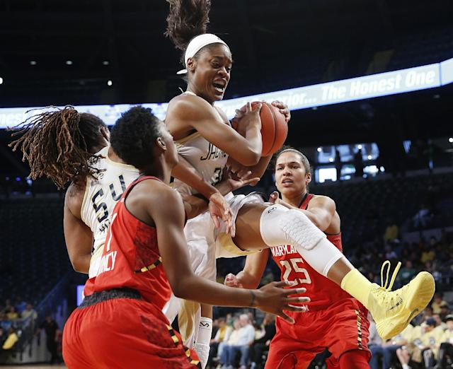 Georgia Tech guard Kaela Davis (3) fights for a rebound against Maryland's Laurin Mincy (1), left, and Alyssa Thomas (25) in the second half of an NCAA college basketball game, Sunday, Feb. 23, 2014, in Atlanta. (AP Photo/John Bazemore)