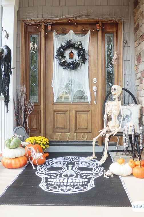 """<p>The spiderweb cheesecloth, black wreath, mini lanterns, and skeleton all make this a winning Halloween scene—but the star of the show just might be that gigantic doormat. Talk about making a statement!</p><p><strong>Get the tutorial at <a href=""""https://www.attagirlsays.com/spooky-halloween-door-decorations/"""" rel=""""nofollow noopener"""" target=""""_blank"""" data-ylk=""""slk:Atta Girl Says"""" class=""""link rapid-noclick-resp"""">Atta Girl Says</a>.</strong></p><p><a class=""""link rapid-noclick-resp"""" href=""""https://go.redirectingat.com?id=74968X1596630&url=https%3A%2F%2Fwww.walmart.com%2Fsearch%2F%3Fquery%3Dskeletons&sref=https%3A%2F%2Fwww.thepioneerwoman.com%2Fholidays-celebrations%2Fg32894423%2Foutdoor-halloween-decorations%2F"""" rel=""""nofollow noopener"""" target=""""_blank"""" data-ylk=""""slk:SHOP SKELETONS"""">SHOP SKELETONS</a></p>"""