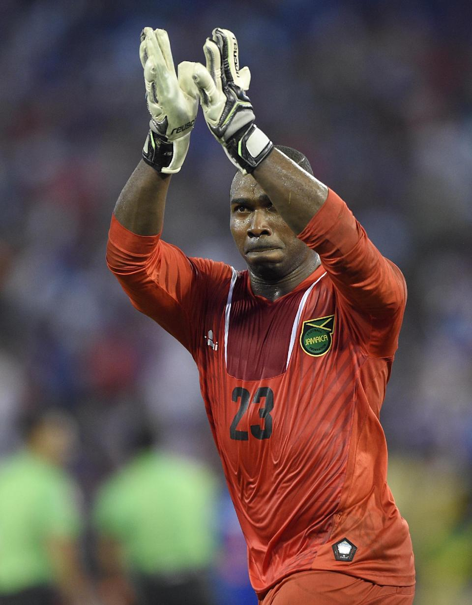 Jamaica goalkeeper Ryan Thompson (23) celebrates after they defeated Haiti 1-0 in a CONCACAF Gold Cup soccer quarterfinal match, Saturday, July 18, 2015, in Baltimore. (AP Photo/Nick Wass)