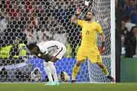 England's Marcus Rashford reacts after missed a penalty shot during the penalty shootout during the Euro 2020 soccer final match between England and Italy at Wembley stadium in London, Sunday, July 11, 2021. (Andy Rain/Pool Photo via AP)