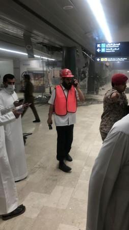 Rescue workers and civilians are seen at Saudi Arabia's Abha airport after it was attacked by Yemen's Houthi groupin in Abha
