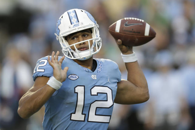 "North Carolina quarterback <a class=""link rapid-noclick-resp"" href=""/ncaaf/players/263532/"" data-ylk=""slk:Chazz Surratt"">Chazz Surratt</a> is one of nine players suspended for four games in 2018. (AP Photo/Gerry Broome)"