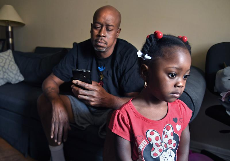 OXON HILL, MD- JULY 16: Thomas Kennerly stopped by his mom's house where he spent some time with his granddaughter (R) Kaiylan (age 4) in Oxon Hill, Maryland on July 16, 2020. He admits that he checks his phone a lot in hopes of hearing some news about his unemployment claim. He normally stays at the home of his brother-in-law in the District. (Photo by Michael S. Williamson/The Washington Post via Getty Images)
