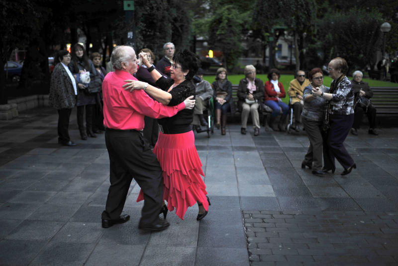 People dance on a public park next to La Casilla sport center where Bildu, the pro independence Basque Party, will be meeting during the electoral night, in Bilbao, northern Spain, Sunday Oct. 21, 2012. Almost 4.5 million people will go to the polls Sunday in regional elections in Spain's turbulent Basque region and in northwestern Galicia. (AP Photo/Alvaro Barrientos)