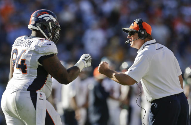Denver Broncos coach Jack Del Rio congratulates defensive tackle Terrance Knighton as he comes off the field during the second half of an NFL football game against the San Diego Chargers Sunday, Nov. 10, 2013, in San Diego. (AP Photo/Gregory Bull)