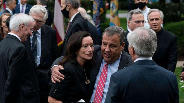 PHOTO: Former New Jersey Gov. Chris Christie speaks with others after President Donald Trump announces Judge Amy Coney Barrett as his Supreme Court nominee in the Rose Garden of the White House, in Washington, D.C., Sept. 26, 2020. (Alex Brandon/AP)