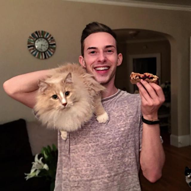 <p>Here Rippon takes a break from figure skating to eat a peanut butter and jelly sandwich and snap a photo with his cat. (Photo via Instagram/adaripp) </p>