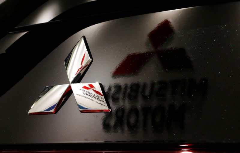 Mitsubishi Motors to cut costs after slump in annual profit