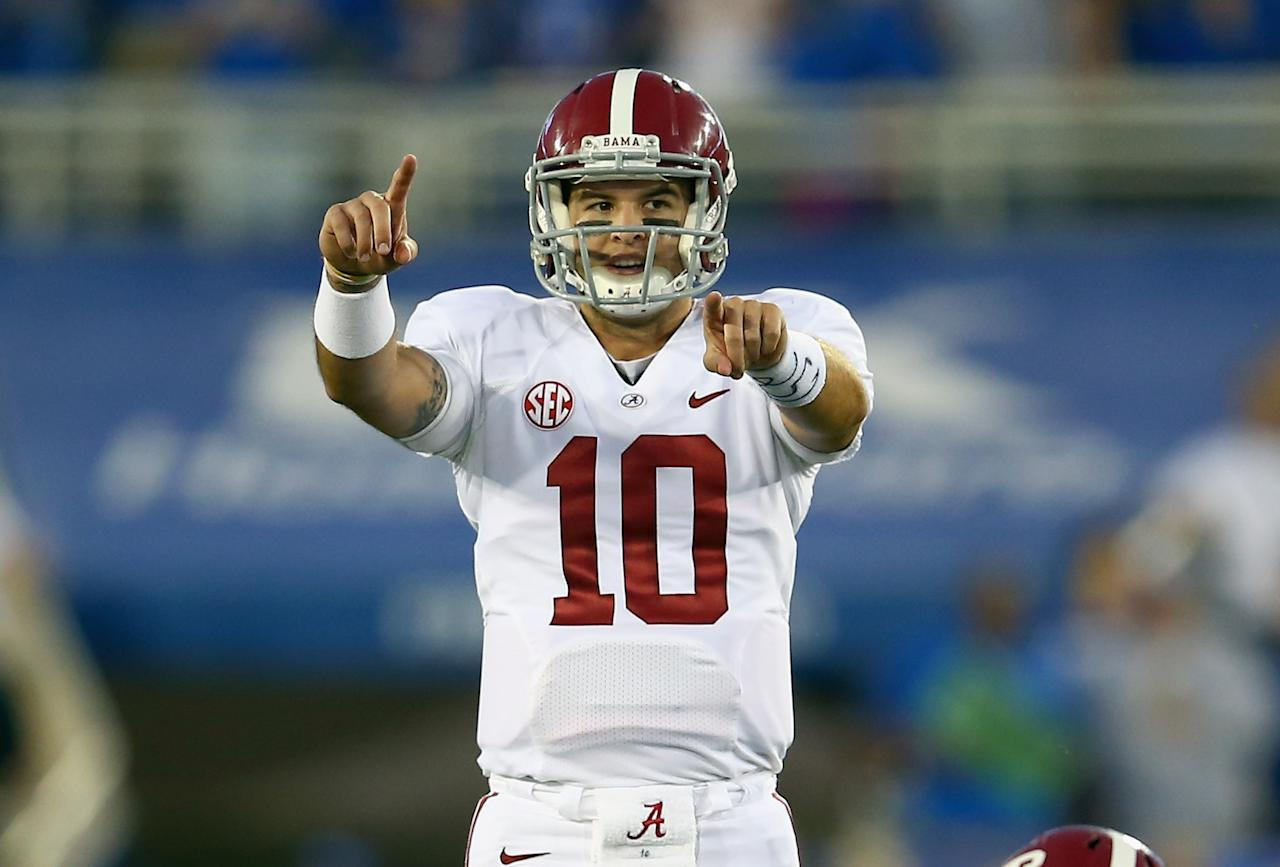 LEXINGTON, KY - OCTOBER 12: A J McCarron #10 of the Alabama Crimson Tide gives instructions to his team during the game against the Kentucky Wildcats at Commonwealth Stadium on October 12, 2013 in Lexington, Kentucky. (Photo by Andy Lyons/Getty Images)