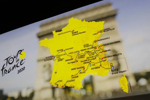 The roadmap of the Tour de France 2020 cycling race is projected on a screen during the event presentation, Tuesday, Oct.15, 2019 in Paris. Like a giant roller-coaster from start to finish over five mountain ranges, next year's Tour de France will feature new summits and only a few time-trial kilometers. (AP Photo/Thibault Camus)