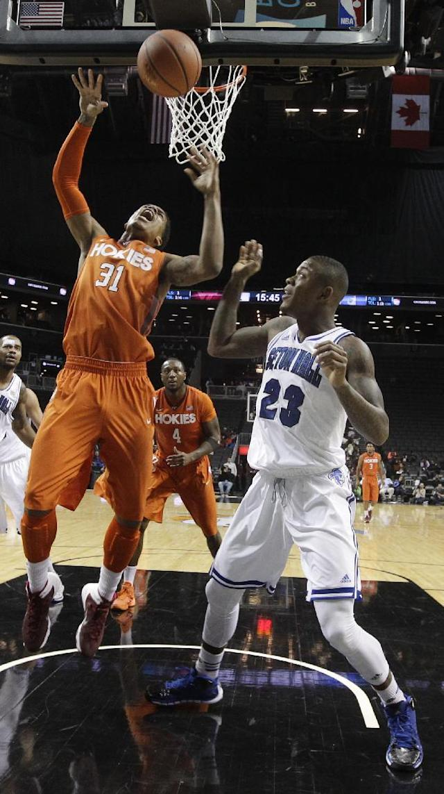 Seton Hall's Fuquan Edwin (23) defends against Virginia Tech's Jarell Eddie (31) during the first half of a consolation game in the Coaches vs. Cancer NCAA college basketball game on Saturday, Nov. 23, 2013, in New York. (AP Photo/Frank Franklin II)