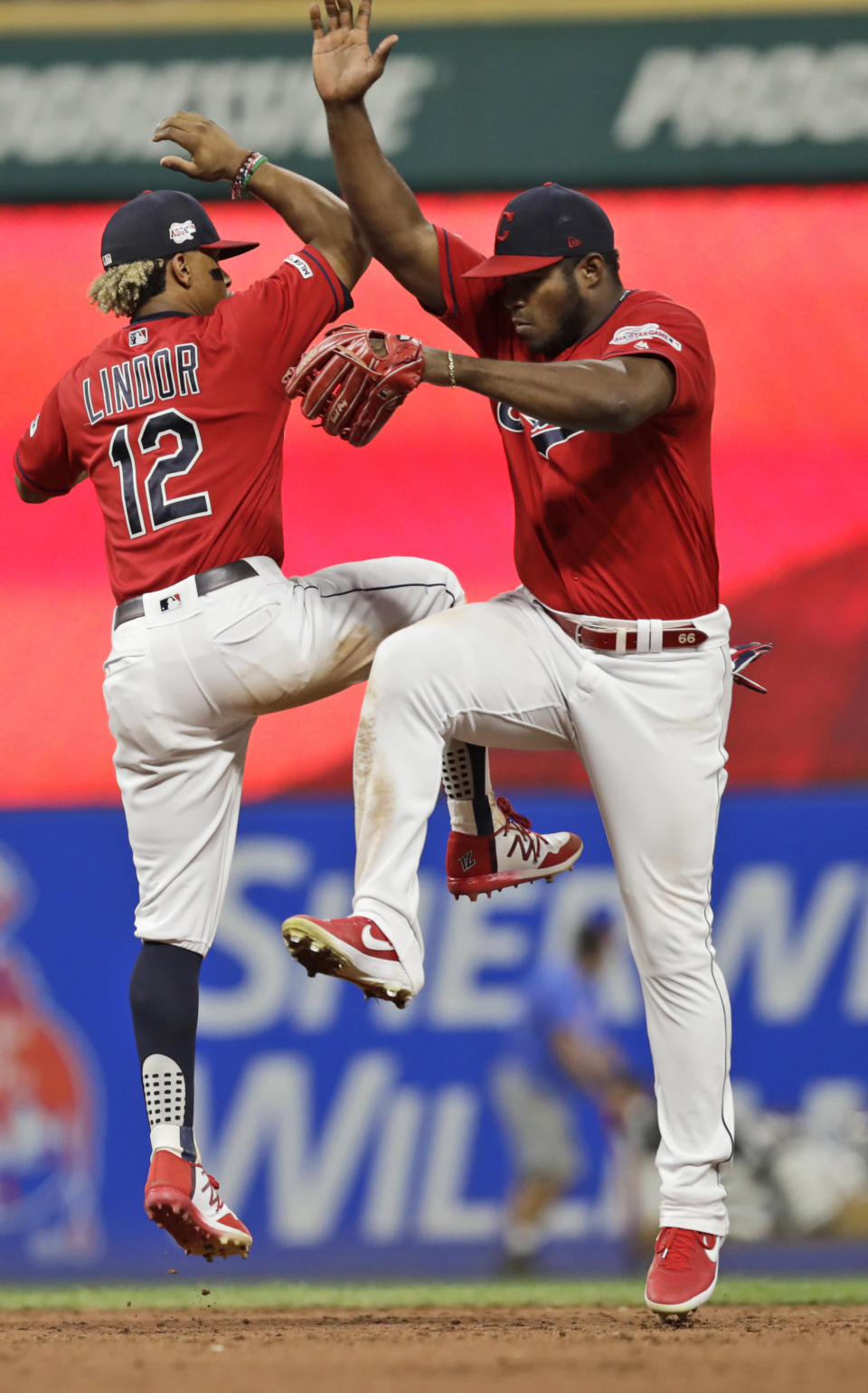Cleveland Indians' Francisco Lindor, left, and Yasiel Puig celebrate after the Indians defeated the Philadelphia Phillies 5-2 in a baseball game Friday, Sept. 20, 2019, in Cleveland. (AP Photo/Tony Dejak)