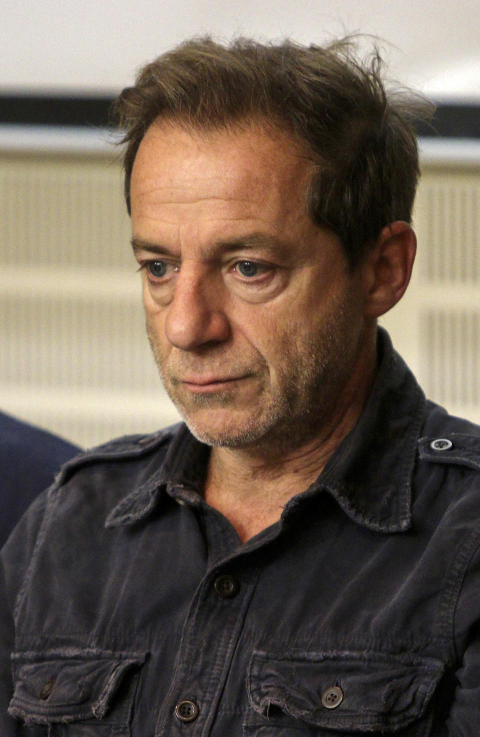 FILE - In this Tuesday, Oct.16, 2018, file photo, Dimitris Lignadis, actor and director, attends a news conference in Athens. On Saturday afternoon, Feb. 20, 2021, Lignadis, 56, turned himself in at Athens police headquarters, police said, and held pending an appearance before a magistrate. Lignadis has denied rape charges. (Christos Doudoumis/InTime News via AP, File)