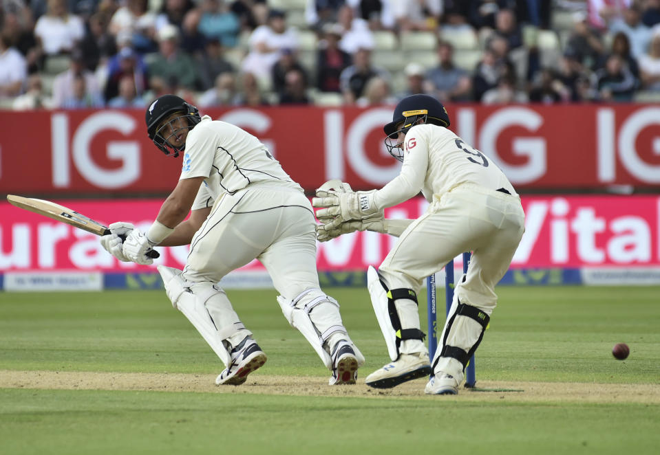 New Zealand's Ross Taylor, left, plays a shot during the second day of the second cricket test match between England and New Zealand at Edgbaston in Birmingham, England, Friday, June 11, 2021. (AP Photo/Rui Vieira)