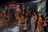 LALITPUR, NEPAL - 2020/10/14: A view of the statues of Hindu goddess Durga prepared for the Dashain festival. Dashain is the most auspicious festival in Nepal which is celebrated for 10 days by Nepalese Hindu people by offering devotion towards the Goddess Durga, marking the triumph of good over evil. Clay idols are transported to different places of Kathmandu valley but according to the artist, due to the covid-19 pandemic less numbers of clay statues are ordered. (Photo by Bivas Shrestha/SOPA Images/LightRocket via Getty Images)