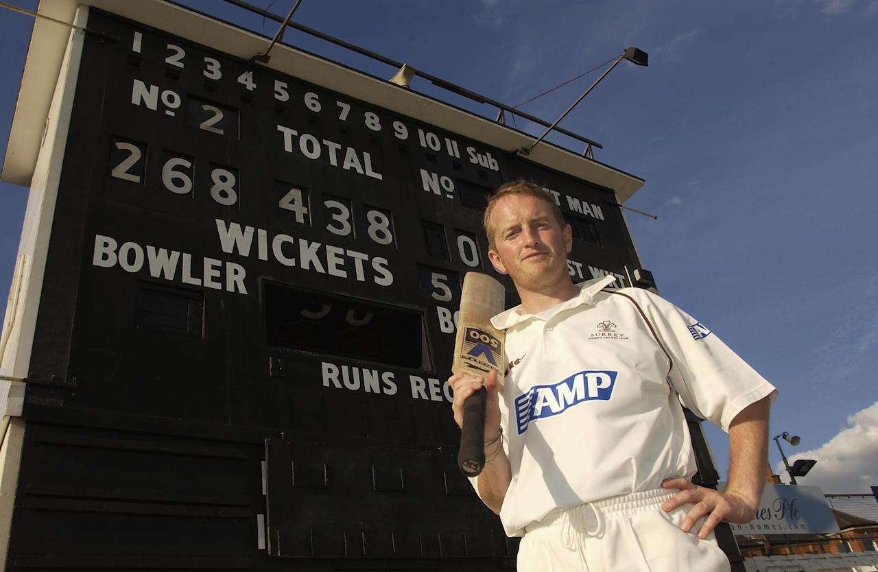 LONDON - JUNE 19:  Alistair Brown of Surrey poses in front of the scoreboard after he scores a world record 268 runs in a team record of 438 in a 50 over match during the Cheltenham and Gloucester Trophy One day match between Surrey and Glamorgan at The AMP Oval, London, England on June 19, 2002. (Photo By Tom Shaw/Getty Images)
