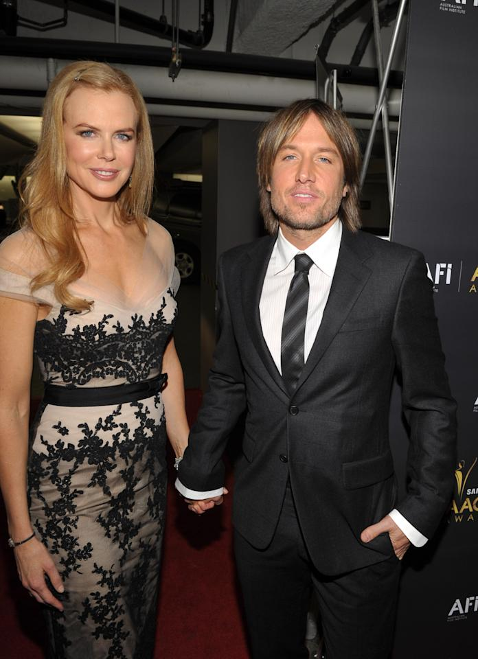 WEST HOLLYWOOD, CA - JANUARY 27:  Actress Nicole Kidman (L) and musician Keith Urban arrive at the Australian Academy Of Cinema And Television Arts International Awards Ceremony at Soho House on January 27, 2012 in West Hollywood, California.  (Photo by John Shearer/Getty Images)