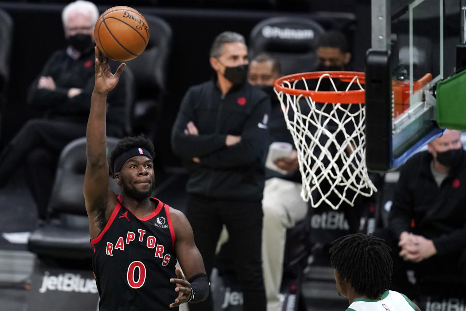Toronto Raptors guard Terence Davis (0) shoots over Boston Celtics center Robert Williams III during the first half of an NBA basketball game, Thursday, March 4, 2021, in Boston. (AP Photo/Charles Krupa)