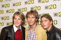 """<p>Founded in the early '90s, three squeaky-clean brothers made up the group Hanson. In 1996, they released their first version of <a href=""""https://www.amazon.com/Mmmbop/dp/B002AV0K7K/?tag=syn-yahoo-20&ascsubtag=%5Bartid%7C10055.g.33861456%5Bsrc%7Cyahoo-us"""" rel=""""nofollow noopener"""" target=""""_blank"""" data-ylk=""""slk:""""MMMBop,"""" class=""""link rapid-noclick-resp"""">""""MMMBop,</a>"""" which later became a huge hit when it was polished up and re-released on their 1997 hit album, """"Middle of Nowhere."""" The album sold 10 million copies worldwide.</p>"""