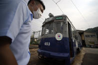 A tram which survived the Hiroshima atomic bombing is seen at a train maintenance facility of Hiroshima Electric Railway in Hiroshima, western Japan Monday, Aug. 3, 2020. It has been restored and repainted its original colors, will run on the street on Aug. 6 to commemorate the day of the U.S. first atomic bombing in the city. (AP Photo/Eugene Hoshiko)