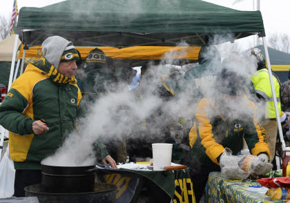 There is no temperature below which these Lambeau fans won't tailgate. (Mike DiNovo-USA TODAY Sports)