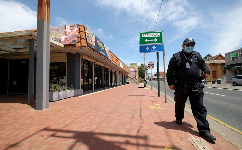 <p>Police outside the Woodville Pizza Bar after it was announced that a worker from the shop 'lied' to authorities during a Covid investigation</p> (Getty Images)