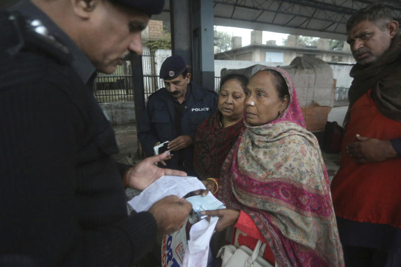 Pakistani police officers check documents of passengers travel to India via Samjhota Express at Lahore railway station in Pakistan, Thursday, Feb. 21, 2019. Indian authorities suspended a bus service this week without explanation. The development comes amid escalated tensions between Pakistan and India in the wake of last week's deadly suicide bombing in Kashmir against Indian paramilitary troops. (AP Photo/K.M. Chaudary)