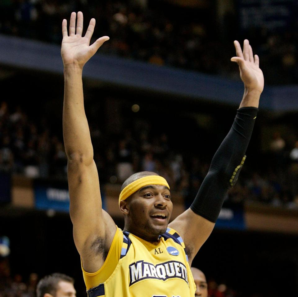 Marquette forward Lazar Hayward (32) celebrates after scoring against Utah State in the second half of a first-round men's NCAA college basketball tournament game in Boise, Idaho, Friday, March 20, 2009. Marquette defeated Utah State 58-57.