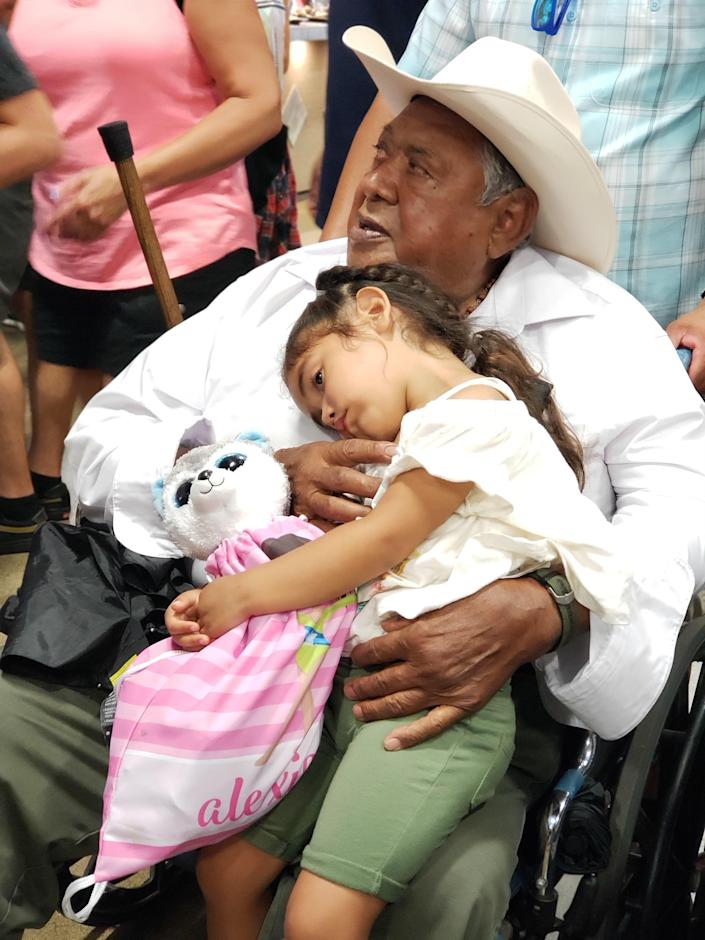 Arturo Andrade, 81, holding his granddaughter, Alexia, was one of the many Hispanic victims of COVID-19 in California.