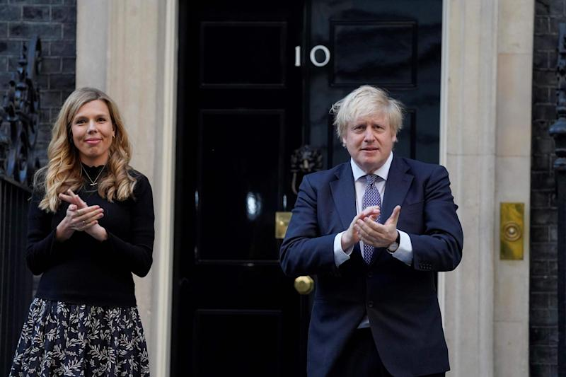 Boris Johnson and Carrie Symonds clap for carers in Downing Street (10 Downing Street/AFP via Getty)