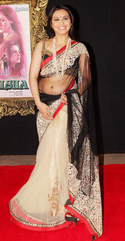 Rani's two tone sari with heavy work should be worn to an evening wedding.