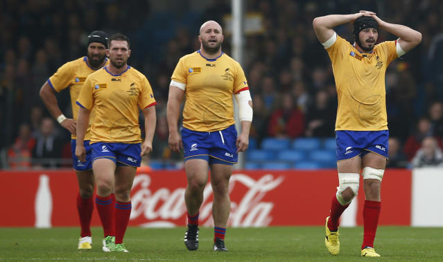 Rugby Union - Italy v Romania - IRB Rugby World Cup 2015 Pool D - Sandy Park, Exeter, England - 11/10/15 Romania's Valentin Poparlan (R) looks dejected Action Images via Reuters / Andrew Couldridge Livepic