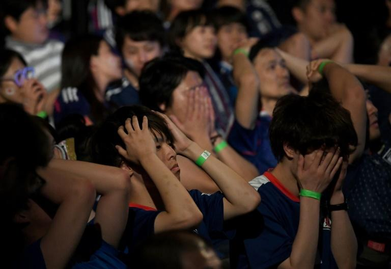 Japanese fans react with dismay as their team crash out of the World Cup after Belgium scored in the dying seconds of the game