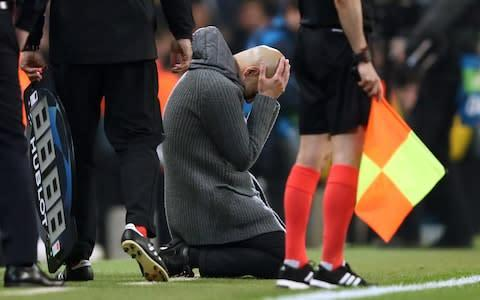 <span>Pep Guardiola looks dejected after Manchester City are knocked out by Tottenham</span> <span>Credit: getty images </span>