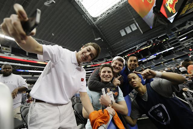 Connecticut guard Shabazz Napier joins a group for a selfie after team practice for their NCAA Final Four tournament college basketball semifinal game Friday, April 4, 2014, in Dallas. Connecticut plays Florida on Saturday, April 5, 2014. (AP Photo/Charlie Neibergall)