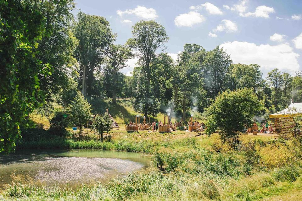 """<p>Tucked away in the beautiful fields of Conbury Park in Oxfordshire, <a href=""""https://www.wildernessfestival.com/"""" rel=""""nofollow noopener"""" target=""""_blank"""" data-ylk=""""slk:Wilderness Festival"""" class=""""link rapid-noclick-resp"""">Wilderness Festival</a> (August 2 – 5) is easy to reach from London and the south. While Groove Armada, Nile Rodgers and Chic and Bastille are among the performers this year, it's the ideal festival if you're looking for more than music. You can spend your days watching contemporary dance, lounging in a hot tub, taking part in a three-legged race or doing a pub quiz. There really is something for everyone – and all ages – at this fairly new weekend festival. <em>[Photo: Wilderness]</em> </p>"""