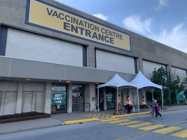The only mass vaccination site currently open in Windsor is located at the former Sears space at Devonshire Mall. (Elvis Nouemsi Njike/Radio-Canada - image credit)