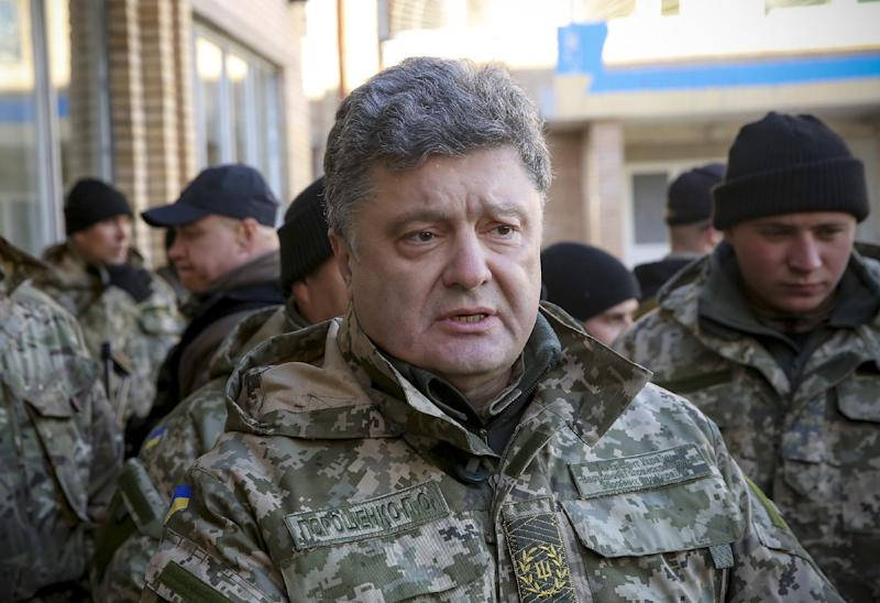 This handout picture taken and released by Presidential press-service shows Ukrainian President Petro Poroshenko during his visit to the eastern Ukrainian city of Kramatorsk on October 26, 2014 (AFP Photo/Mikhail Palinchak)