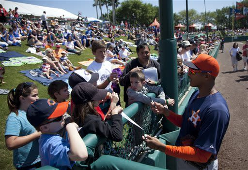 Houston Astros outfielder Justin Maxwell talks with fans before the start of a spring training baseball game against the Atlanta Braves on Thursday, March 28, 2013, in Kissimmee, Fla. (AP Photo/Evan Vucci)