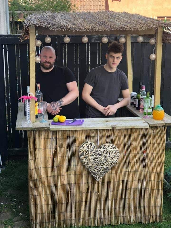 James and Josh are proud of their lockdown bar. (SWNS)
