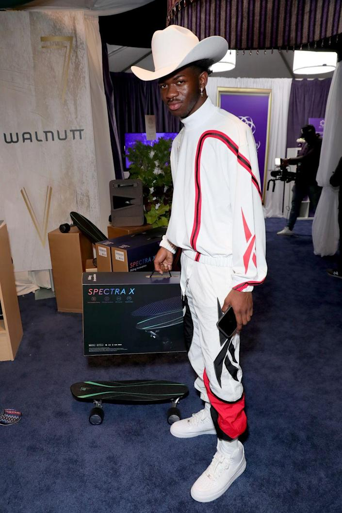 <p>During this quick photo-op, Lil Nas X showed off more of his 21st-century ranchero style. </p>