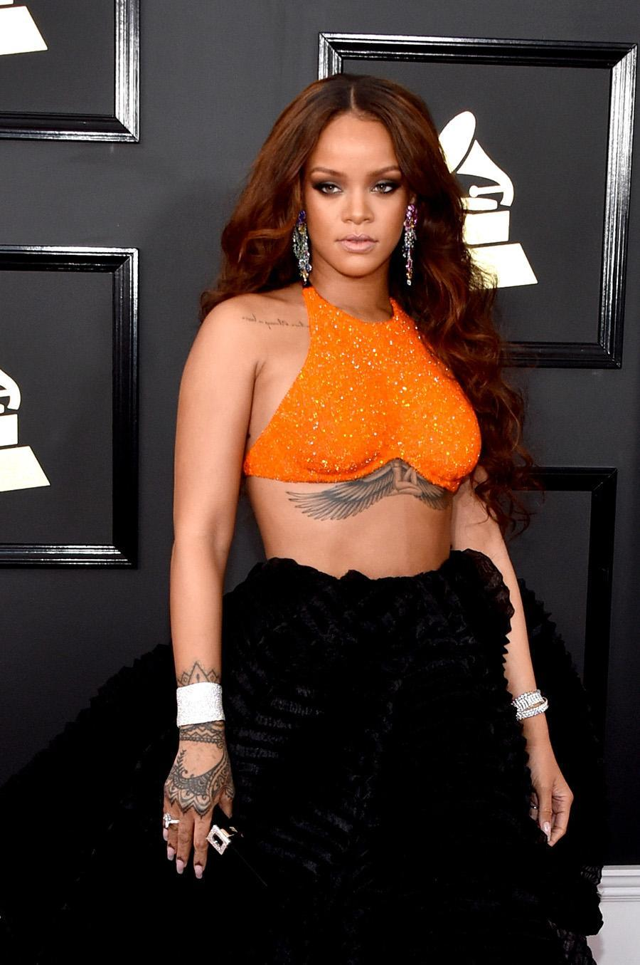 <p>Rihanna showed off long, luscious ringlets and a scene-stealing winged tattoo. (Photo: John Shearer/WireImage) </p>