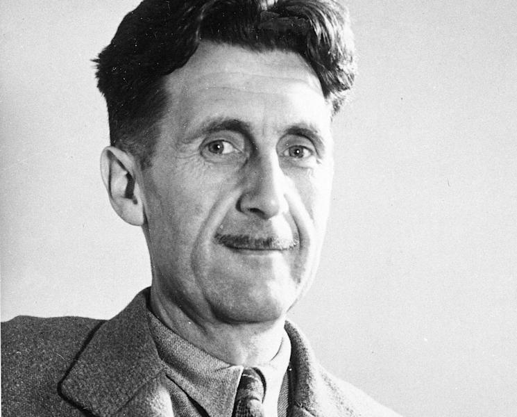 """FILE - In this file photo, writer George Orwell poses in this undated photo at an unknown location. Pearson PLC will merge its Penguin Books division with Random House, which is owned by German media company Bertelsmann, in an all-share deal that will create the world's largest publisher of consumer books, it was reported on Monday, Oct. 29, 2012. The planned joint venture brings together classic and best-selling names. As well as publishing books from authors such as John Grisham, Random House scored a major hit this year with """"Fifty Shades of Grey."""" Penguin has a strong backlist, including George Orwell, Jack Kerouac and John Le Carre. (AP Photo, File)"""