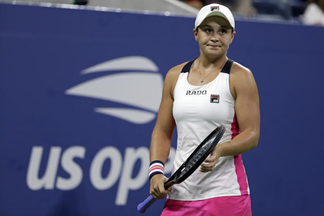 "FILE - In this Aug. 28, 2019, file photo, Ashleigh Barty, of Australia, reacts against Lauren Davis during the second round of the U.S. Open tennis tournament in New York. Barty has joined the ranks of high-profile players concerned over the staging of the U.S. Open while there's still so much uncertainty around the coronavirus pandemic. ""I have concerns too,"" Barty said in an e-mail to The Associated Press. ""I understand the tournaments are eager to run but keeping everyone safe has to be the priority."" (AP Photo/Adam Hunger, File)"