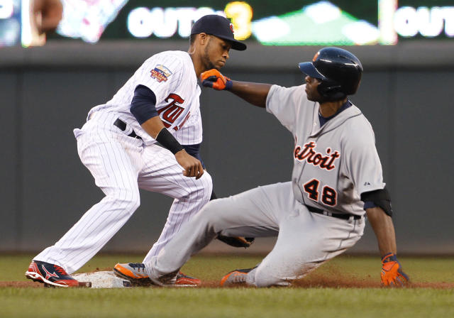 Detroit Tigers' Torii Hunter (48) is safe at second base on a double as Minnesota Twins shortstop Pedro Florimon, left, applies the late tag during the third inning of a baseball game in Minneapolis, Friday, April 25, 2014. (AP Photo/Ann Heisenfelt)