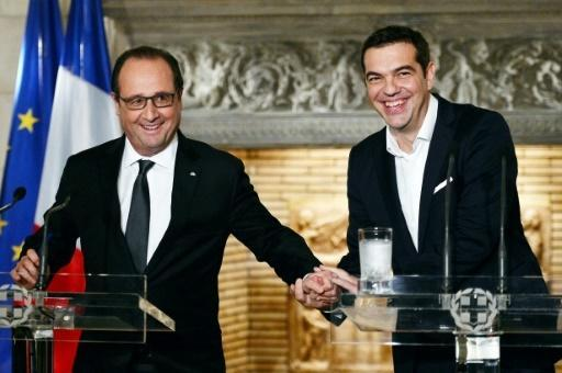 Hollande vows to help Greece on reforms, refugees