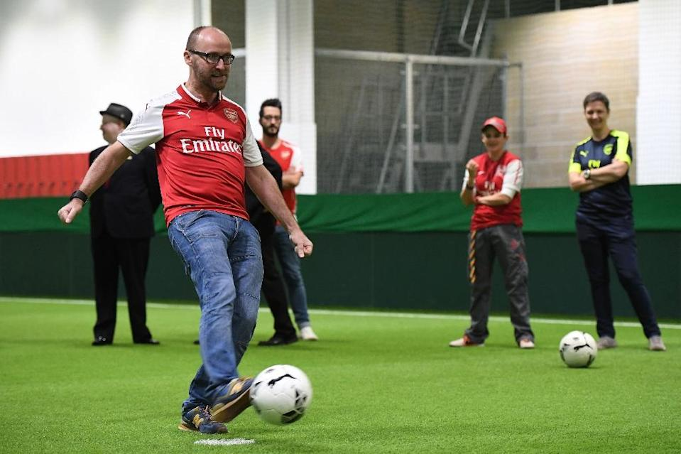 Players from the gay supporters' teams of Arsenal and Brighton take part in a penalty shoot-out competition at the Arsenal Hub in north London on October 1, 2017 (AFP Photo/Chris J RATCLIFFE)